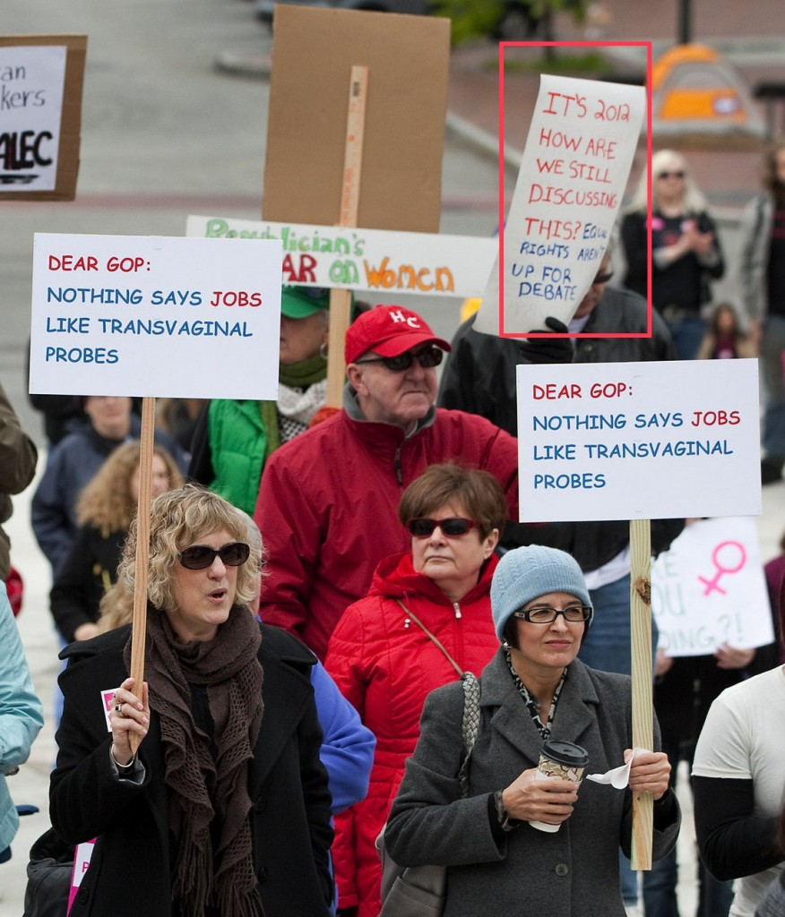 "image of a protest against abortion restrictions. One sign says ""It's 2012. How are still discussing this? Equal Rights aren't up for debate."""